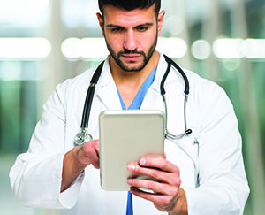 Doctor with electronic tablet