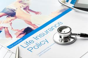 stethoscope on life insurance policy