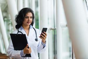 doctor checking smartphone
