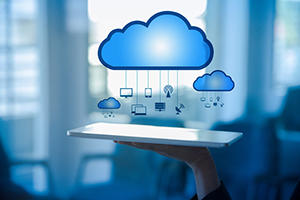 tablet with cloud computing iconography