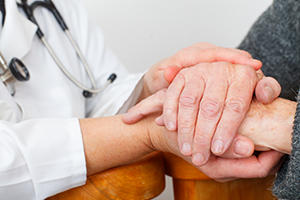 doctor's hands comforting patient