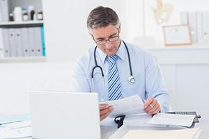 doctor reading letter