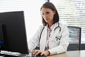 doctor checking CURES database