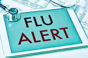 flu season alert on tablet computer