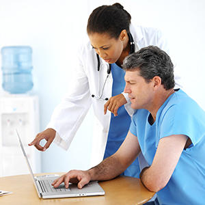 physicians checking computer