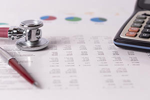 stethoscope on financial paperwork