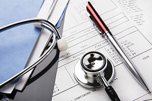 stethoscope on paperwork